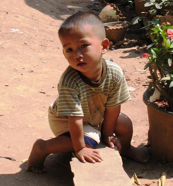 Young boy at Me Kong River village near Luang Prabang