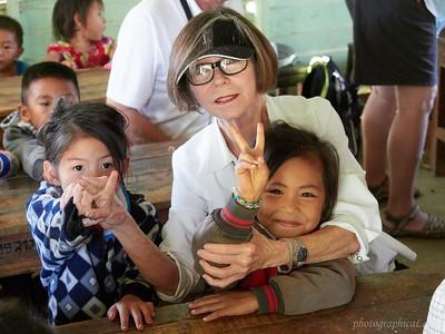 Linda with school children at Laos village