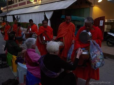 Alms to monks at dawn in Luang Prabang