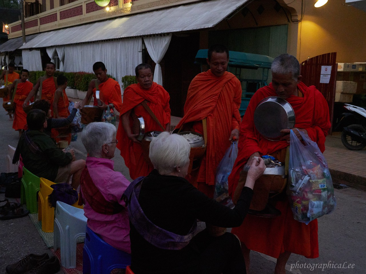 Alms to monks at dawn in Luang Prabang