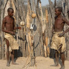 Our guide and the elder display some of their handmade tools and bows and arrows.