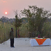 On a sandy island at a set of falls in the Okavango River, we enjoyed the sundown.<br /> September 17, 2013