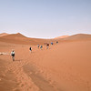 Hiking the last 1.6 kilometer (1 mile) to the Dead Vlei.
