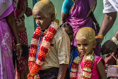 Children who have just had their heads shaved outside a Hindu temple in the Georgetown area of Chennai