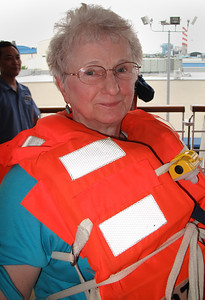 Before sailing, everyone has to attend the safety drill.  Sally finally got the vest on correctly and gave me a smile.