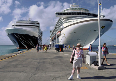 "Sally has on SPF 45 and is ready for our day ashore.  She didn't bring her hat, so she ""borrowed"" mine."