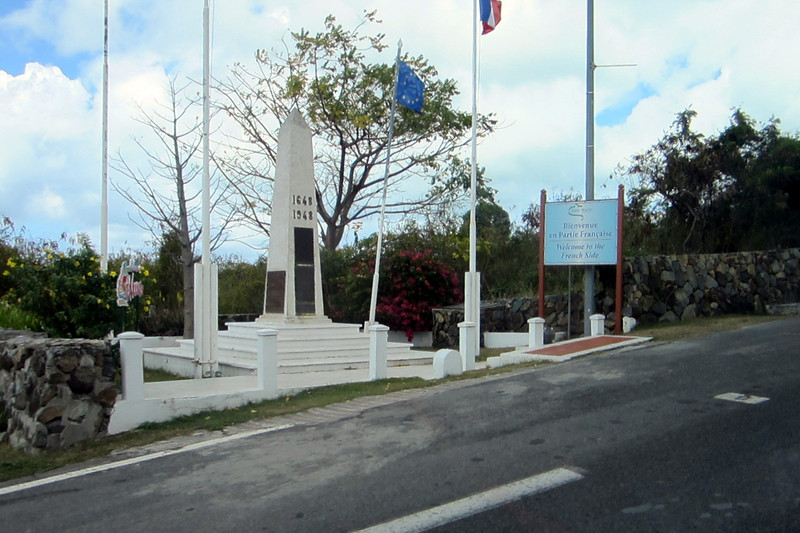 A roadside marker to welcome travelers to the French side of the island (St. Martin).
