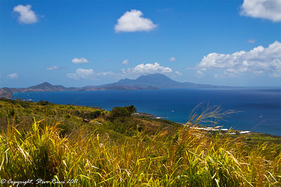 View of the Caribbean Sea while horseback riding up to the rainforest in St. Kitts