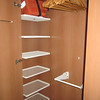 Lots of hangers, with storage shelves on the side of the closet.  Lower rods fold up/down.