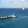 Refueling barge heads toward the cruise ships as Celebrity Reflection approaches St. Maarten.