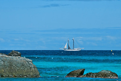 A sailboat in the distance near Trunk Bay.