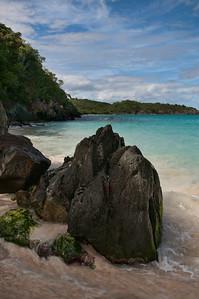 Beautiful Trunk Bay as seen over the shoreline rocks.
