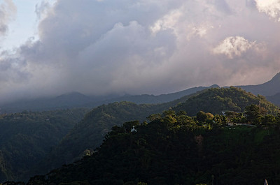 A cross at the tip of one of the mountains on Dominica.