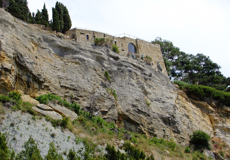 A Romanesque building on a rocky cliff above Cassis.
