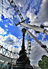 London Eye, shown with one of the elaborate nearby street lamps.