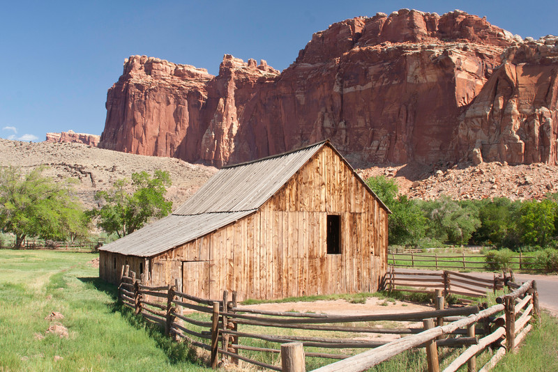 Ranch house with red rock butte behind near Grafton, Utah