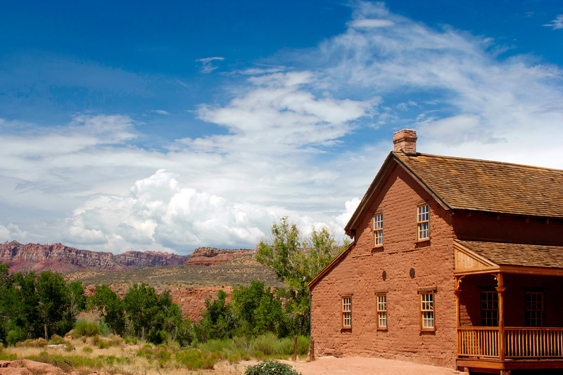 A deserted building in Grafton Ghost Town, with approaching storm clouds