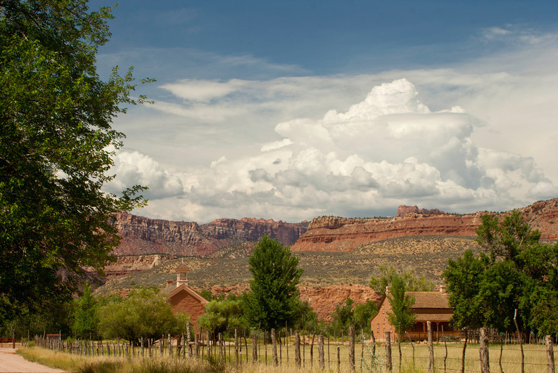 Storm clouds over Grafton Ghost Town and distant buttes