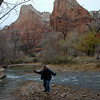 Chuck playing in the Virgin River with the Court of the Patriarchs behind.