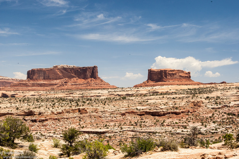 "Along the way to Canyonlands National Park and Dead Horse State Park - Monitor and Merrimac Mesas. The larger butte to the left (Merrimac) is at 38o 39' 49"" N, 109o 44' 33"" W. The smaller butte to the right (Monitor) is at 38o 39' 38"" N, 109o 44' 06"" W."