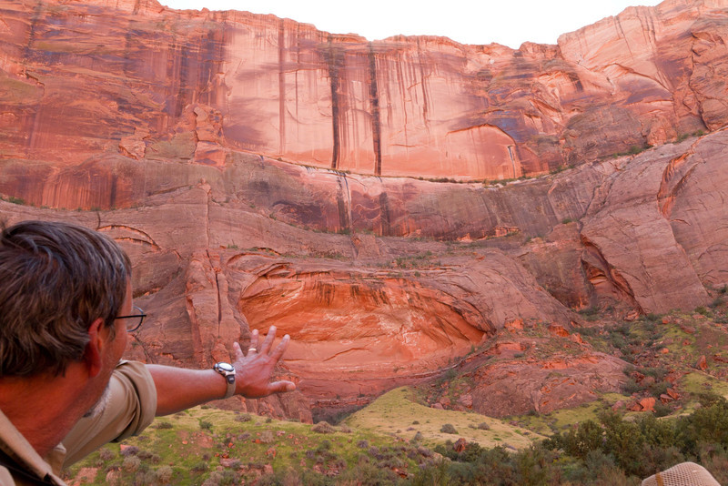 Our guide points our natural arches that occur as rock falls away form the walls of the canyon