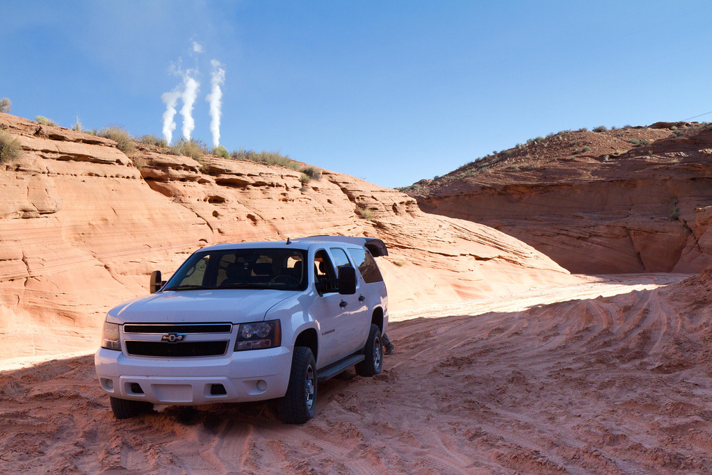 The next day, outside Page, we entered the Navajo reservation for a half day tour of the slot canyons. Our Navajo guide had a 4 wheel drive necessary to get around that area. The smokestacks in the background belong to the Navajo Power Generating Station, which burns coal