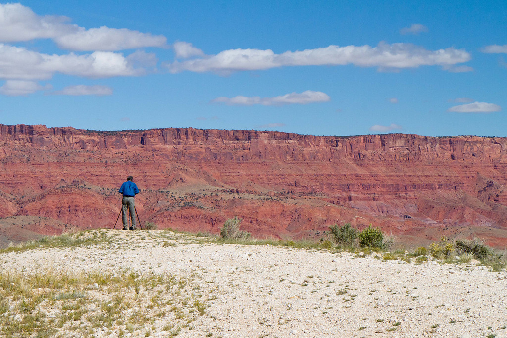 "Ken shooting the Vermillion Cliffs. Deep in the back recesses of these cliffs, 20 miles away, lies the famous ""Wave""- a wonder of sandstone and wind carving. Google it. We tried to get in, but the lottery allows only 20 people a day in and we did not make the cut."