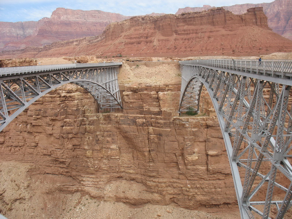 These are the Navajo Bridges affixed to the canyon walls. The one on the right is older and smaller and is now used by visitors to view the canyon.<br /> <br /> The total length of the bridge is 834 ft. and its height is 467 ft. The original bridge was built 1927-28.