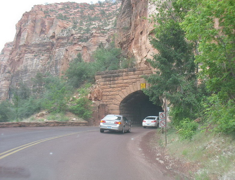 Leaving Zion through the tunnel. 1.1 miles long and built for much smaller vehicles than today. Large vehicles need a special escort through it.<br /> <br /> Once leaving Zion, we traveled north to Panguitch, UT where we spent the night. A fairly long stretch of highway with few services and we thought for awhile that we might be dipping into our snacks for dinner until we finally found a restaurant.