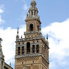 The Giralda is the bell tower of the Cathedral of Seville. The tower's first two-thirds is a former Almohad minaret which, when built, was the tallest tower in the world at 97.5 m (320 ft) in height. It was one of the most important symbols in the medieval city.