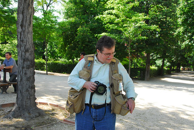Alan fooling around trying to find a filter.  The vest looks a little dorky, but it really does the job for a tourist photographer.  It has padded pockets that will hold four lenses much like a camera bag.  As far as I know it's the only one like it.  The vests are custom made, so they can only be purchased from the supplier -  The Vested Interest.