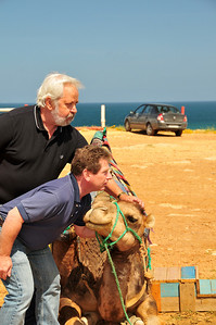 Nick & Jim pose with the camel.  The camel is trying to figure out what they're doing.