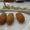 Foreground: Croquetas de Jamon (Ham croquettes)<br /> Background: Fried anchovies with lemon