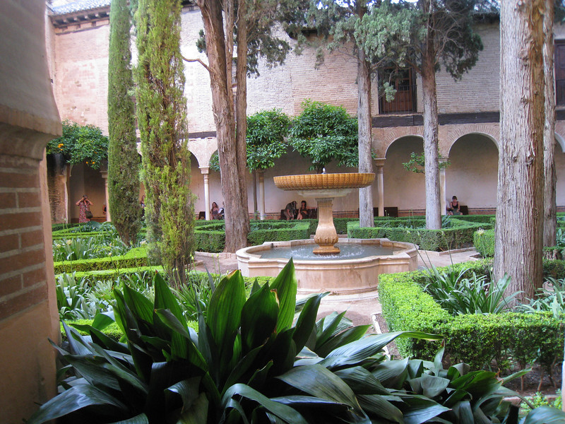 Granada - an ornate garden inside the Palacio Nazaríes.