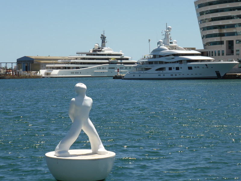 "Barcelona - two ""super yachts"" which were docked in the harbour.  The yacht on the left is ""Eclipse"" and the one on the right is ""Valerie""."