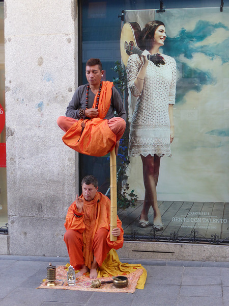 "Madrid - these two street performers created an interesting ""optical illusion"" on the street outside the hotel one evening.  Those providing a donation were provided with a printed ""good luck wish"" which was provided by a girl standing to the right just outside the photo."