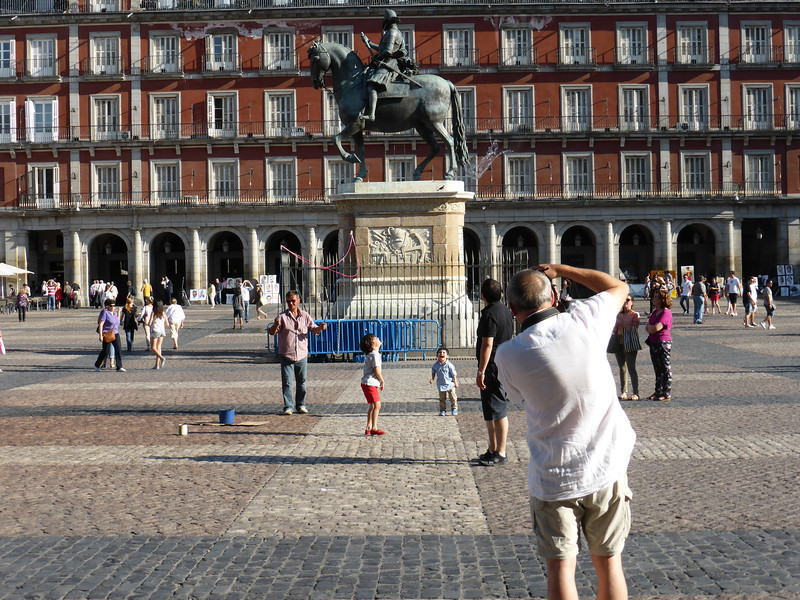 Madrid - a photo of a person taking a photo in Plaza Mayor.
