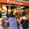 Barcelona - the Pinotxo Tapas Bar, with Juan reaching for a plate.  This was made famous on the Rick Steves travel shows.