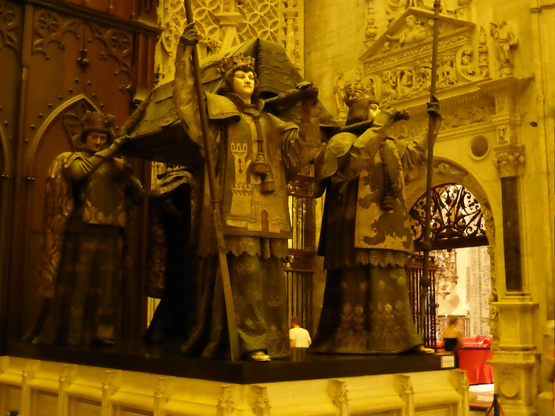 Seville - these statues are more significant than might first appear.  The object being carried by the kings of Castile, Leon, Aragon and Navarre contains the remains of Christopher Columbus, who died in May 1506.  Columbus had been interred in Havana, Cuba for some time but was moved back to the Cathedral of Seville in 1898.