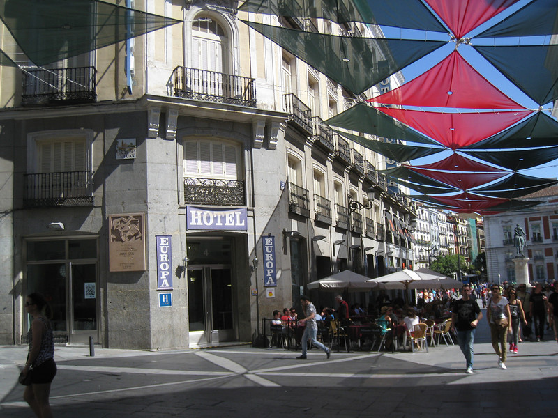 Madrid - the street area outside Hotel Europa.  The suspended shades really make a difference in keeping the atmosphere comfortable.
