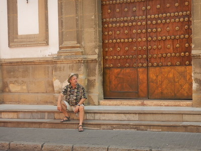 Ed taking a rest in front of an old church