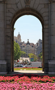 Madrid - View through central arch of Puerta de Alcala along Calle de Aleala.