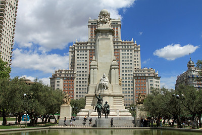 Madrid - Plaza de Espana, and the stone obelisk with statue of the Spanish author Miguel de Cervantes.  Below him, Don Quixote rides his horse Rocinante while the plump Sancho Panza trots alongside with his donkey.  Built in 1928.