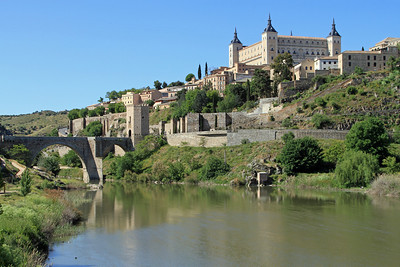 Toledo - Alcazar and Puente de Alcantara (bridge) over the Rio Taja (river).