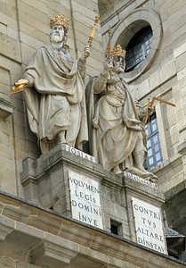 El Escorial - Statues (two of the six kings of Judah?) above the entrance to the basillica at San Lorenzo de El Escorial.