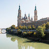 Zaragoza is the capital of northeastern Spain's Aragon region. Overlooking the Ebro River in the city center is baroque Nuestra Senora del Pilar basilica, a famous pilgrimage site with a shrine to the Virgin Mary and multiple domes. Mudejar-style landmarks, combining Islamic and Gothic architecture, include the Aljaferia, an 11th-century Moorish palace, and the Cathedral of the Savior, begun in the 12th century.