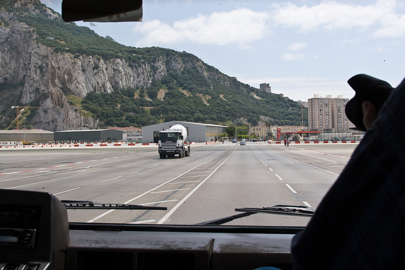 The road from the mainland into Gibraltar cuts right across the airport runway.  Traffic has to be stopped at each edge of the runway when planes need to takeoff or land.