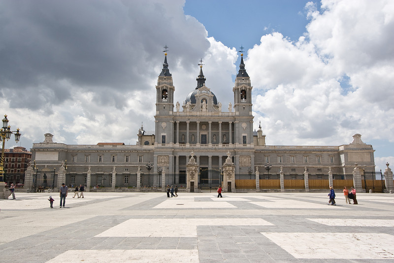 The Almudena Cathedral is located across the courtyard from the Royal Palace