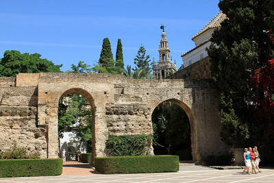Alcazar - The Patio de la Monteria, the central courtyard of the Alcazar with La Giralda (Cathedral bell tower) in the background.