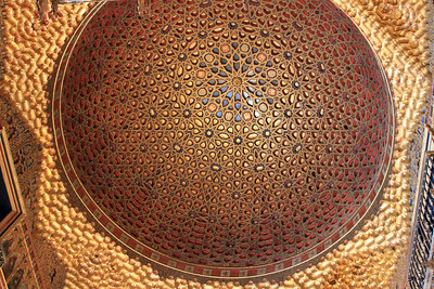 Alcazar - Ceiling of the Salon de Embajadores (Hall of the Ambassadors).  This wooden carved ad gilded dome of multiple star patterns symbolises the universe and was added to the palace in 1427.